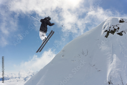 Sticker Flying skier on mountains. Extreme winter sport.