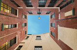sky view from below between buildings concept and space for your text - 230413004