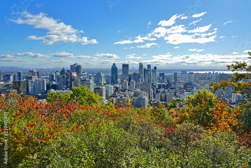 Scenic view of the city of Montreal in Quebec with colorful autumn foliage from the Chalet du Mont Royal (Mount Royal) Kondiaronk belvedere viewpoint