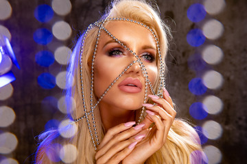 Beauty blond woman with silver jewelry