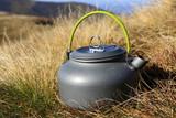 tourist kettle on meadow - 230421410