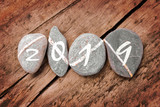 2019 written on a lign of stones on a wooden background - 230423055