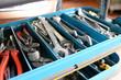 Closeup open tool cabinet with tools for repair in a car repair shop // Closeup offener Werkzeugschrank mit Werkzeugen zur Reparatur in einer Autowerkstatt