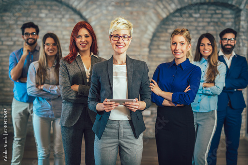 Group of happy business people and company staff in modern office, representig company.