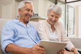Seniors using digital tablet - 230430001
