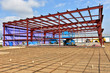 Re inforcement rod and steel framework of commercial building under construction.building under construction.