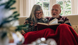 Senior couple reading a book together - 230460804
