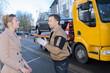 Leinwanddruck Bild - car towing worker talking to customer