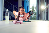 Girl doing push up - 230472028