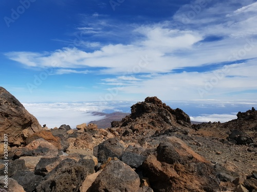 Beautiful scenery over the clouds from the big famous volcano Pico del Teide in Tenerife, Europe - 230482897