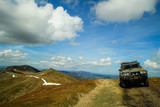 Offroad car.Ukrainian picturesque Carpathians. Mountain trip. Traveling with friends. Landscapes from the top. Trees. Autumn