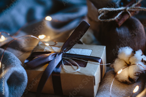 Cozy winter composition with eco gifts and christmas lights, flat lay, mock up, macro photo - 230487831