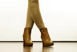 Woman wearing suede leggings and high heels - 230489882