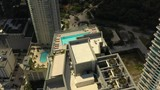 Sunbathing at a rooftop pool aerial footage - 230494062