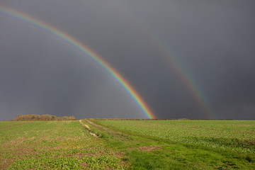 double rainbow over farmland in lincolnshire