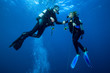 Leinwanddruck Bild - Happy couple scuba divers  hovering together on a safety stop