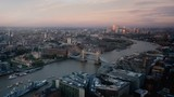 time lapse London skyline with illuminated Tower bridge and Canary Wharf in sunset time, UK - 230502250