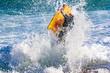 Quadro Flight of bodyboarder boy when crashing wave on the beach