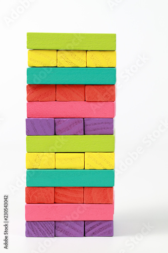 Wooden block stacking, Financial and Business growth concept using as background © Parkpoom