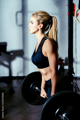 Leinwanddruck Bild athletic young woman