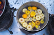 Leinwandbild Motiv Hot gluhwein or mulled wine in a cauldron at fair,traditional citrus drink on fair. Christmas market.