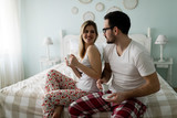 Picture of of happy young couple spending morning together - 230571420