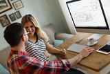 Young attractive designers working together from home - 230572093
