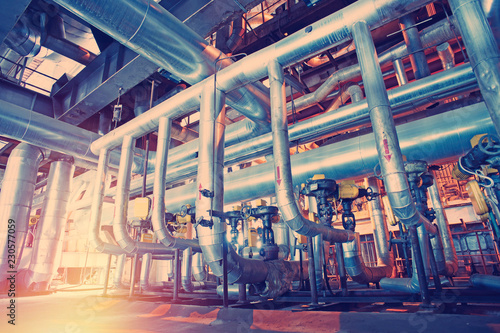 Leinwanddruck Bild Equipment, cables and piping as found inside of a modern industrial power plant