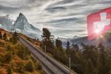 Matterhorn peak with railway against sunset in Swiss Alps, Switzerland - 230580280