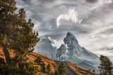 Matterhorn peak with railway against sunset in Swiss Alps, Switzerland - 230580686