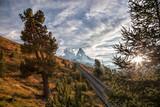 Matterhorn peak with railway against sunset in Swiss Alps, Switzerland - 230580810