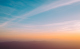 Dramatic sunset and sunrise over mountain morning twilight evening sky. - 230581063
