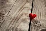 kindness concept, kind actions, sharing love and compassion, red heart on wooden background - 230581285
