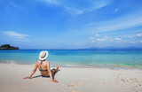 Vacation on paradise white sand beach, tropical holidays travel,  woman tourist  relaxing near turquoise sea. - 230581466