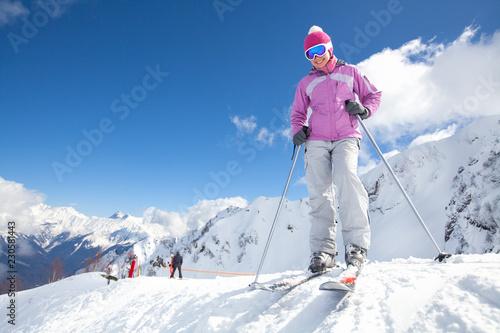 Leinwandbild Motiv woman skiing  in the mountains