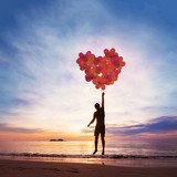 Kindness and love concept, child flying with heart from balloons. - 230581631
