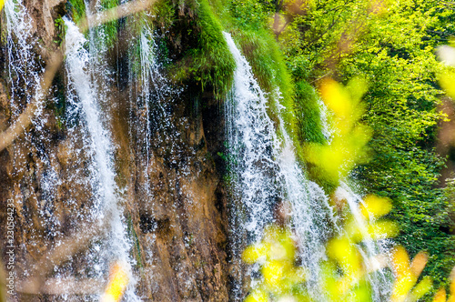 Waterfall streams surrounded by forest flora in Plitvice Lakes National Park, Croatia © YKD
