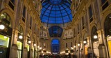Evening view of the Vittorio Emanuele II gallery in Milan, Italy. Time lapse. - 230590072