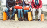 Group of friends sitting outdoor with shopping bags - 230597037