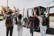 Young People having Fun in front of Tour Bus