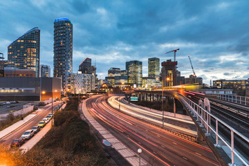 Urban view with skyscrapers, blurred train and traffic light trails © william87