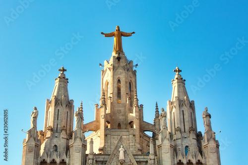 Sculpture of the Sacred Heart of Jesus on the Sagrat Cor church in Tibidabo mountain over Barcelona, Spain