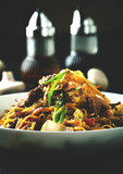 Noodles with meat and vegetables and teriyaki sauce