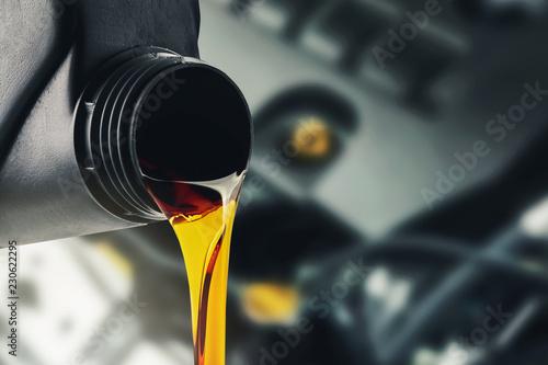 Leinwanddruck Bild pouring changing car engine oil