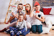 Leinwanddruck Bild - Portrait of happy family with christmas mask