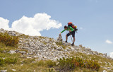 Hiker with a stone man - Vran mountains - 230636077