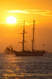 Beautiful sunset and sailboats at Mallory Square Pier in Key West Florida