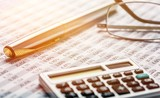 Calculator, pen, glasses and the financial report. Close up - 230641652