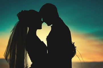 Portrait of young wedding couple embracing
