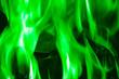 Leinwandbild Motiv green flame on black background, background for placing text
